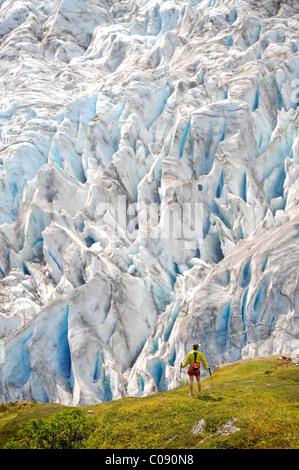 Woman hiking  Exit Glacier in the Harding Icefield, Kenai Fjords National Park, Kenai Peninsula, Southcentral Alaska - Stock Photo