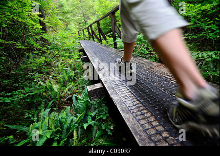 Close up of a woman hiking on the Perseverance Lake trail in Tongass National Forest near Ketchikan, Southeast Alaska, - Stock Photo