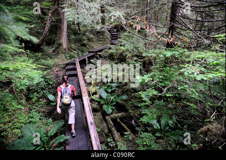 Woman hiking on the Perseverance Lake trail in Tongass National Forest near Ketchikan, Southeast Alaska, Summer - Stock Photo