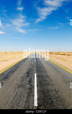 Lonely deserted road in the Namibian desert between Windhoek and Swakopmund, Namibia, Africa - Stock Photo