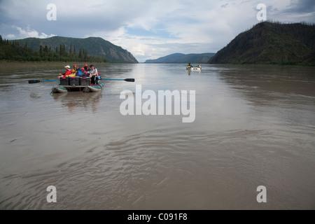 Two rafts of families float down the Yukon River, Yukon-Charley Rivers National Preserve, Interior Alaska, Summer - Stock Photo