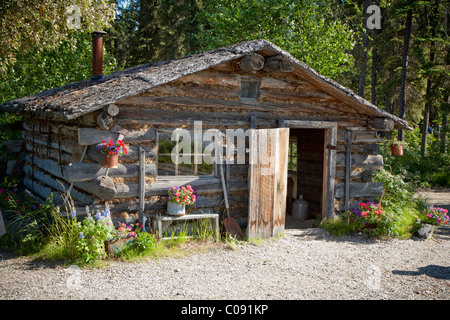 Trapper's style log cabin at Chena Indian Village on the Riverboat Discovery tour, Fairbanks, Interior Alaska, Summer - Stock Photo