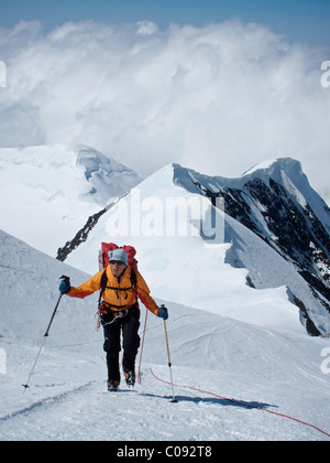 Woman makes her way to Windy Corner on the West Buttress Route, Kahiltna Glacier on Mt. McKinley, Denali National - Stock Photo