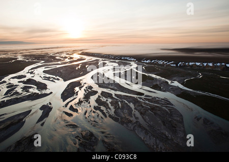 Aerial view of a sunrise over the Sagavanirktok River and fog hanging over the Franklin Bluffs near the Dalton Highway, - Stock Photo