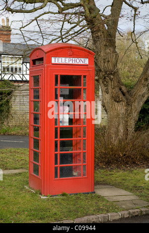An original red telephone / coin operated phone / payphone / call box in Holyport, Berkshire. UK. - Stock Photo