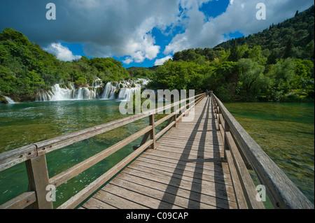 Wooden bridge and waterfalls in Krka National Park, aeibenik-Knin County, Croatia, Europe - Stock Photo