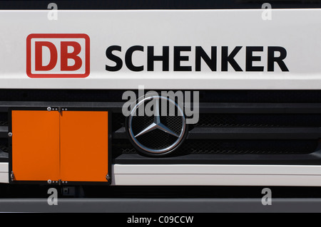 Grille of a Mercedes Benz truck by DB Schenker with a closed warning sign, transportation and logistics, Logo Deutsche - Stock Photo
