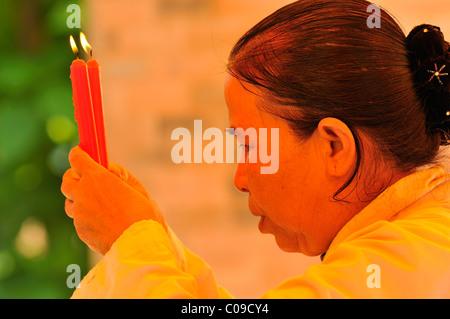 Praying woman, Vietnam, Southeast Asia