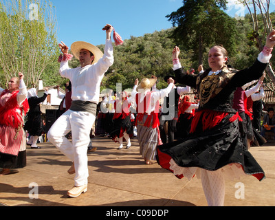 Portuguese folk dancers in traditional costume at the Festa da Fonte Grande May festival in Alte, Algarve, Portugal, - Stock Photo