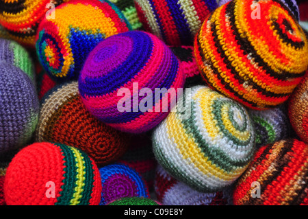 close up of brightly coloured woollen juggling balls - Stock Photo