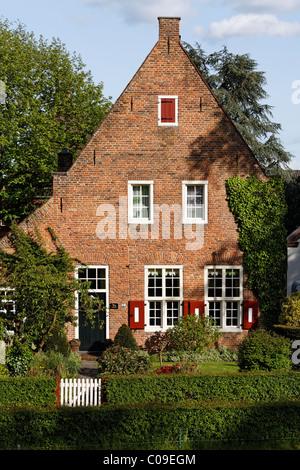 Historic brick home near Huis Bergh castle, 's-Heerenberg, Gelderland, Lower Rhine region, Netherlands, Europe - Stock Photo