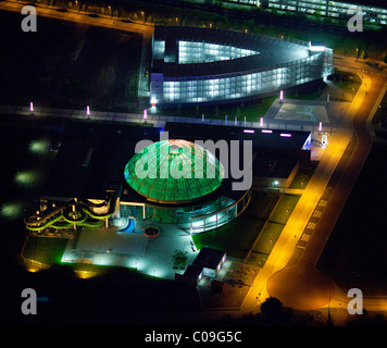 Aerial view, night, new center with gasometer, Centro, new water park, theater at night, Oberhausen, Ruhrgebiet - Stock Photo