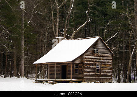 Carter Shields Cabin and Fresh Snow in Cades Cove in the Great Smoky Mountains National Park in Tennessee - Stock Photo