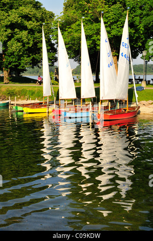 Colourful sailing boats in the harbor of Prien on Lake Chiemsee, Chiemgau, Bavaria, Germany, Europe - Stock Photo