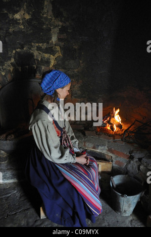 Woman at old stove in a museum, Oestarp, Skåne, Sweden, Europe - Stock Photo