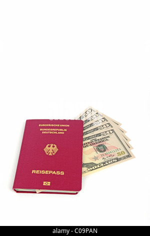 Several 50 dollar bills, passport of the Federal Republic of Germany, symbolic image for travel planning - Stock Photo