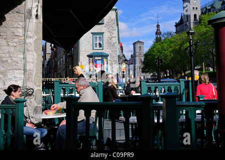 Tourists enjoying a balmy evening in a sidewalk cafe in the historic town centre of Quebec City, Quebec, Canada