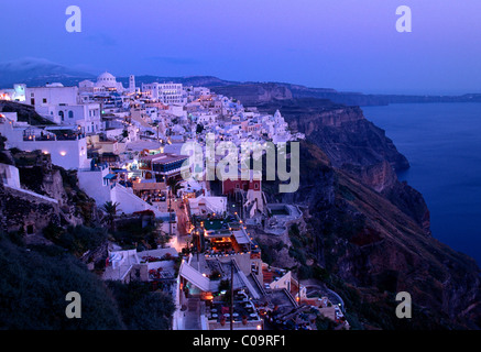 Town of Thira, Fira, on the crater rim, with typical Cycladic architecture, at dusk, Santorini, Cyclades, Greece, - Stock Photo