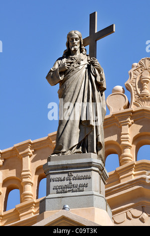Christ-figure with cross on the facade of the Iglesia Catedral cathedral, Cordoba, Argentina, South America - Stock Photo