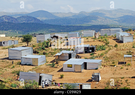Temporary corrugated iron huts without water and electricity in an informal settlement on the edge of the Township - Stock Photo