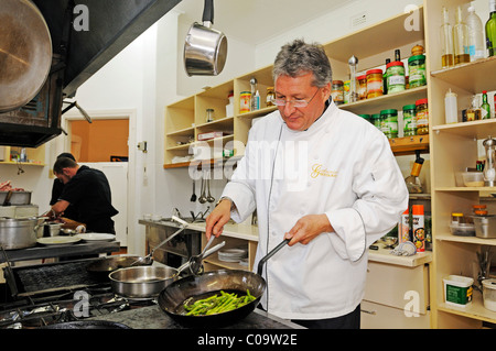 Swiss restaurateur Urs Gamma in his restaurant in the historic center of Gathemann Windhoek, Namibia, Africa - Stock Photo