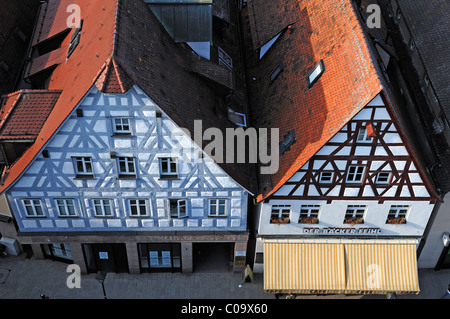 View from the tower of the Johanniskirche church on two old Franconian half-timbered houses, market place, Lauf - Stock Photo