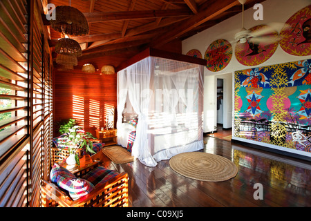 Hotelroom with original art by Claude Sandoz, Luxury Hotel Anse Chastanet Resort, LCA, St. Lucia, Saint Lucia - Stock Photo
