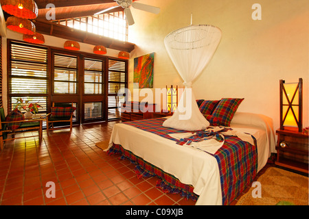 Large hotelroom, naturally ventilated through construction method, mosquito net, Luxury Hotel Anse Chastanet Resort, - Stock Photo
