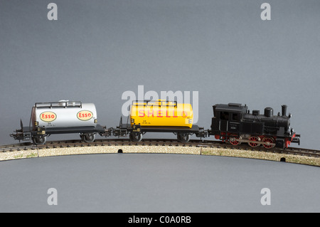 Marklin model train set with Shell and Esso fuel tankers - Stock Photo