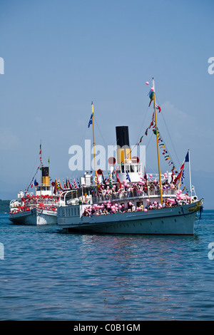 Swiss lake steamers on Lake Geneva by the town of Rolle - 1 - Stock Photo