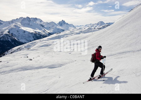 Skier on ski route 33 from Kapall in Austrian Alps in St Anton am Arlberg, Tyrol, Austria, Europe. - Stock Photo