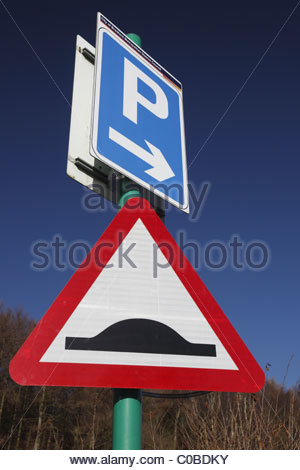 Road signs - Parking and Road Humps - Stock Photo
