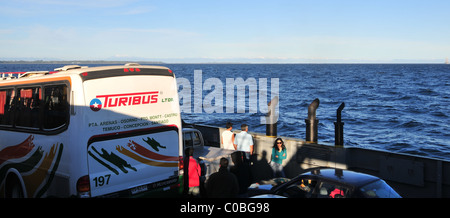 Blue sky view, towards Andes, of Turibus, car, lady  with sunglasses on the deck of a ferry  from Chiloe Island - Stock Photo