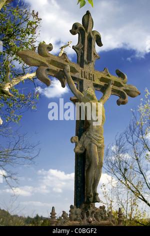 vintage iron crucifix against blue sky - Stock Photo