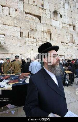 Religious Jew praying at the Western Wall in Jerusalem - Stock Photo