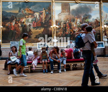Versailles, France - Tourists with children Visiting French Art Museum in, Chateau de Versailles - Stock Photo