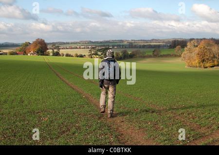 Rambler walking the Clarendon Way, near Winchester, Hampshire, England, UK - Stock Photo
