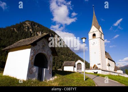 The Kapellenweg (Chapel Road) to the church in Schmitten, Graubunden, Switzerland - Stock Photo
