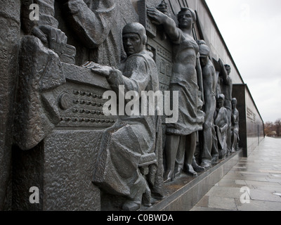 Figures on the base of the Space Obelisk monument, Moscow, Russia. - Stock Photo