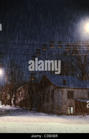 Winter scene with snowfall, Ukraine, eastern Europe - Stock Photo
