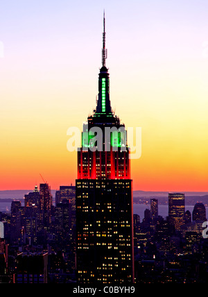 Empire state building in New York illuminated in Christmas colors - Stock Photo