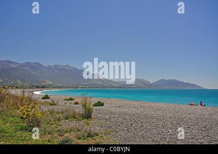 View of beach and Kaikoua Coast, Kaikoura, Canterbury, South Island, New Zealand - Stock Photo
