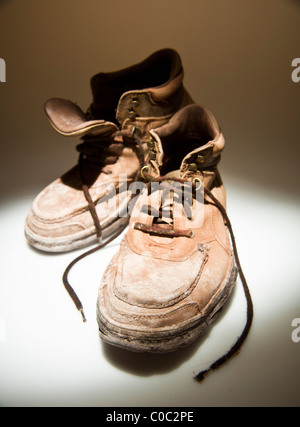 Worn out hiking boots - Stock Photo