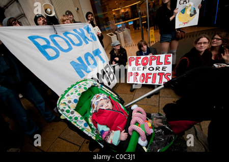 UK Uncut organise a protest against Barclays Bank in London.  A baby from Hastings attends its first protest - Stock Photo