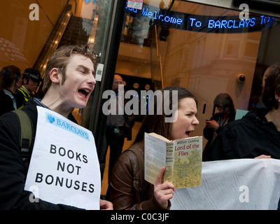 UK Uncut organise a protest against Barclays Bank in London, closing several branches, because they pay so little - Stock Photo