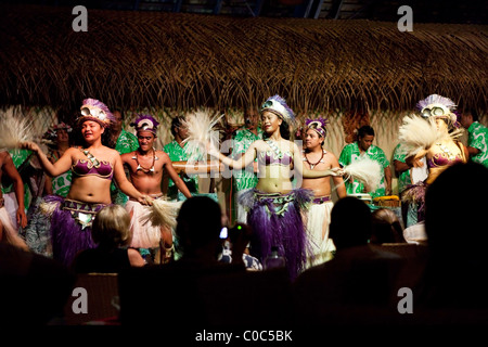 Traditional polynesian dancers on Rarotonga in The Cook Islands in The South Pacific - Stock Photo