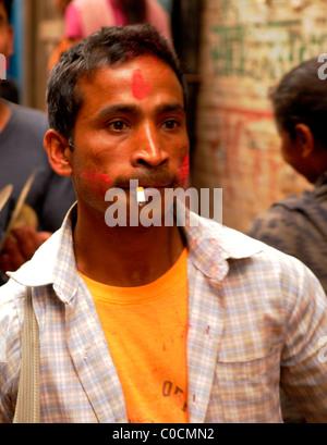 nepalese man smoking , peoples lives ( the nepalis ) ,  life in kathmandu , kathmandu street life , nepal - Stock Photo