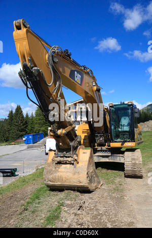 Caterpillar digger in the French Alps - Stock Photo
