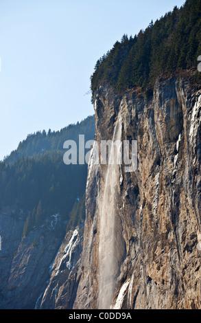 Staubbach waterfall in Lauterbrunnen, Berner Oberland, Switzerland - Stock Photo