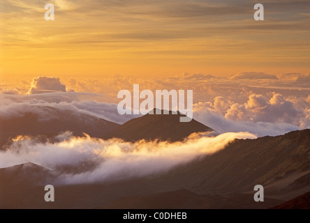 Clouds and crater rim at sunrise, Haleakala National Park; Maui; Hawaii. - Stock Photo